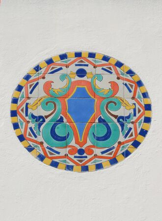Ceramic Tile Mosaic or Ornament On White Facade Wall