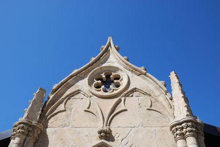 White Chapel Wall Against Blue Sky photo