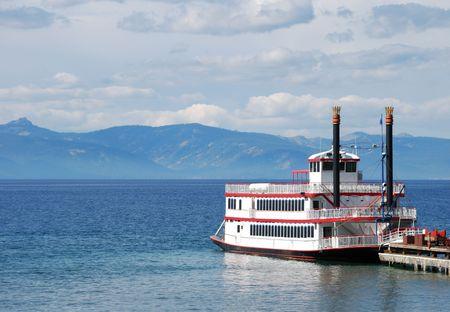 Paddle wheel boat docked on a lake