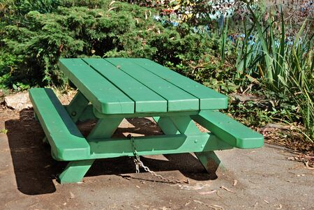Green picnic table on a sunny day Stock Photo - 3863719