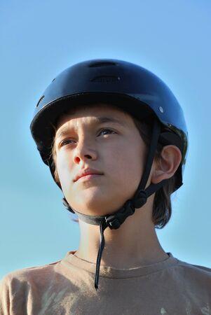 Portrait of a boy wearing a skateboard helmet Stock Photo