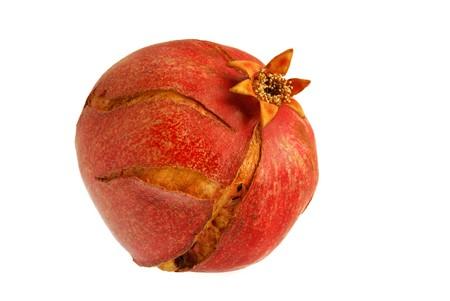 Cracked pomegranate isolated on white background photo