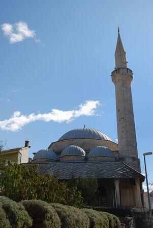 bosna: Karadjozbeg Mosque in Mostar, Bosnia and Herzegovina with blue sky in background. Stock Photo