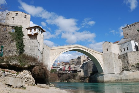 Old Bridge in Mostar, Bosnia and Herzegovina with the old town and blue sky in background photo