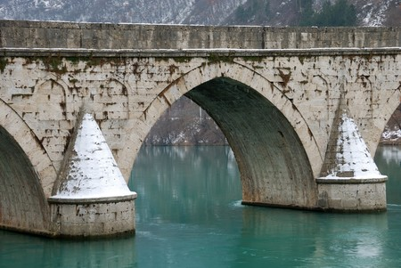 visegrad: Detail of the bridge on the Drina in VIsegrad, Bosnia and Herzegovina on a winter overcast day.