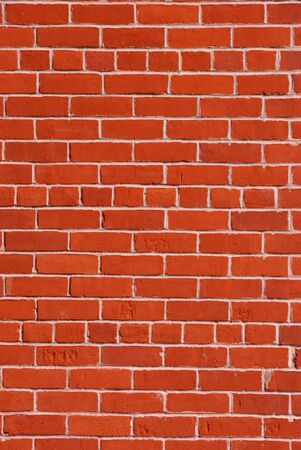 Red brick wall with light cement in between. Stock Photo - 4469950