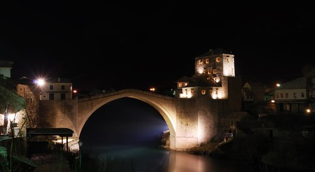 Old Bridge in Mostar at night reconstructed in 2003 after the original from 1556. photo