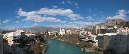 Panorama of Neretva river in Mostar Old Town on a sunny winter day. photo