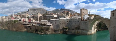 neretva: Panorama of Mostar old town east side with Old Bridge on a sunny winter day.