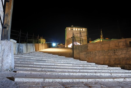 Entrance to the Old Bridge in Mostar at night reconstructed in 2003 after the original from 1556. photo