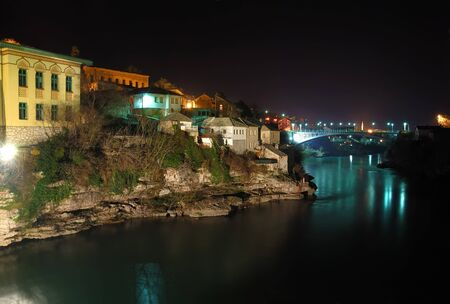Mostar old town at night with the Luka Bridge above the Neretva river. photo
