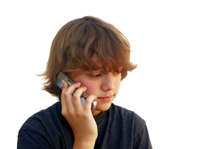 Teen boy talking on mobile phone isolated on white background. photo