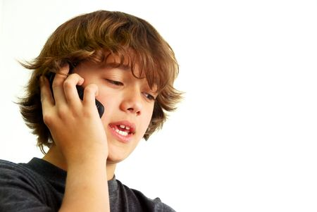 preteen boy: Teenage boy talking on mobile phone isolated on white background.