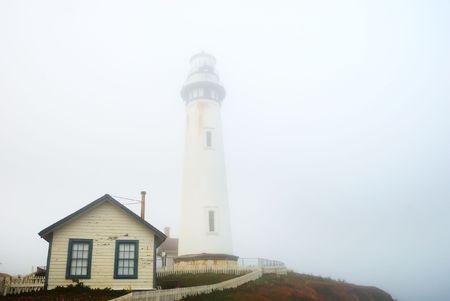 Pigeon Point Lighthouse near Pescadero, California on a foggy day. photo