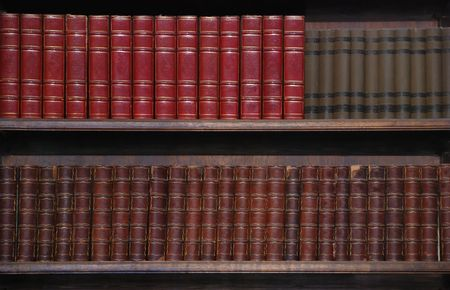 legal document: Two rows of old books on bookshelves.