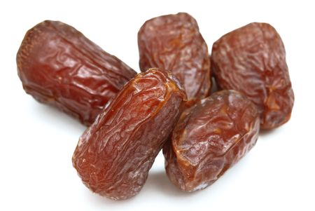dry fruit: Five dry dates isolated on white background.