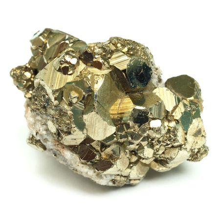 pyrite: A close up of iron pyrite mineral isolated on white background.
