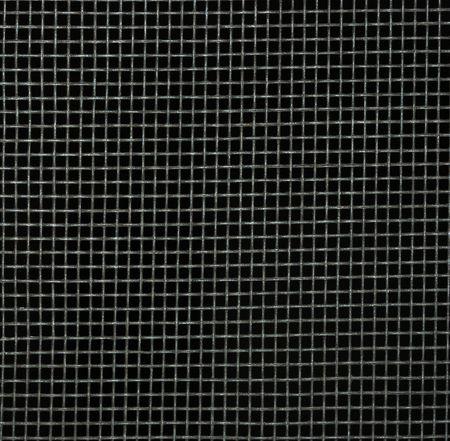 Screen door detail pattern against dark background.