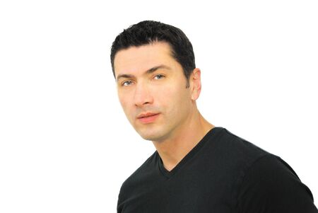 A portrait of a serious man in his thirties wearing black t-shirt over white background. Stock Photo