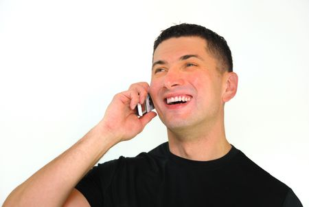 A portrait of a smiling Caucasian man talking on a mobile phone isolated over white background.