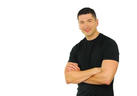 A portrait of a smiling Caucasian athletic man with his arms crossed isolated over white background.