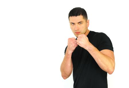 A portrait of a Caucasian man in ready to fight position isolated over white background