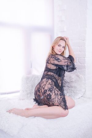 plus size caucasian woman dressed in a beautiful lace black lingerie