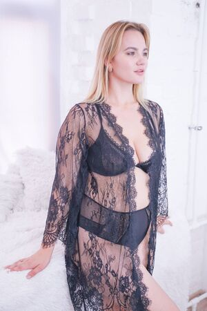 plus size caucasian woman dressed in a beautiful lace black lingerie