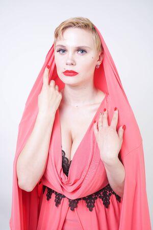 portrait of short-haired plump woman in pink evening dress Standard-Bild