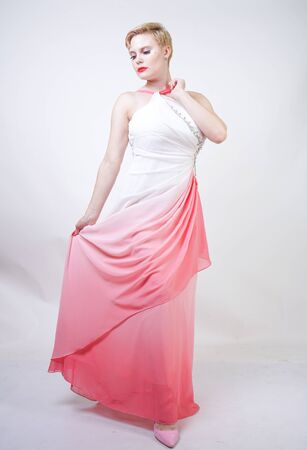 portrait of short-haired plump woman in pink evening dress