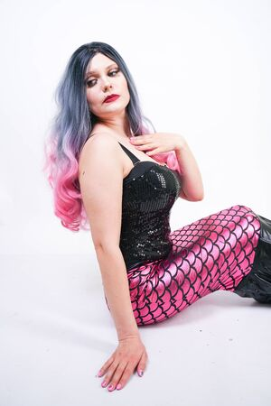 Gothic plus size adult mermaid on white studio background