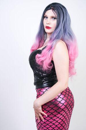 Gothic plus size adult mermaid on white studio background