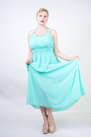 curvy plus size woman in long mint blue dress