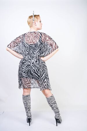 attractive pretty woman wearing zebra dress in studio