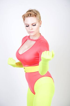 curvy girl in spandex leotard with pantyhose and gloves Stockfoto