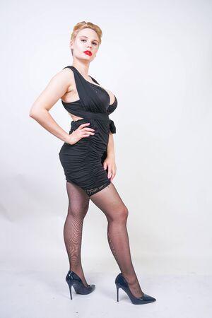 pretty plus size woman in transformer black dress