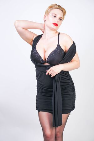 pretty plus size woman in transformer black dress