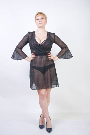 Beautiful woman in trendy chiffon black transparent dress