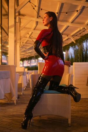 brave girl in latex walks in public and shows her exhibitionism Stock Photo
