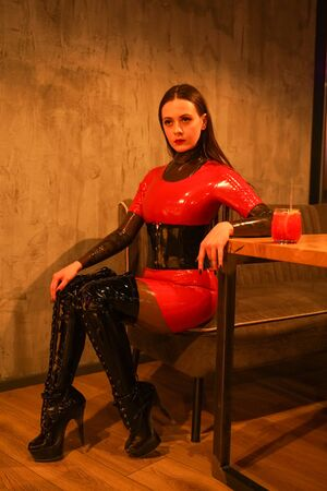 brave girl in latex walks in public and shows her exhibitionism Stock fotó