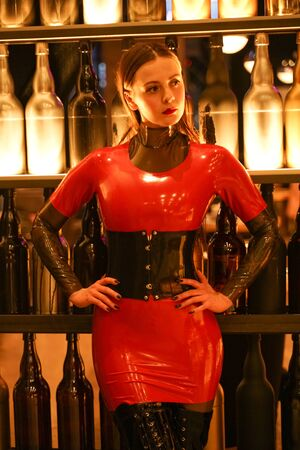 brave girl in latex walks in public and shows her exhibitionism Banco de Imagens