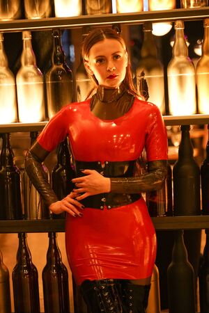 brave girl in latex walks in public and shows her exhibitionism