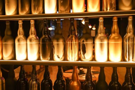 Set of wine bottles in the fashion city cafe with nobody