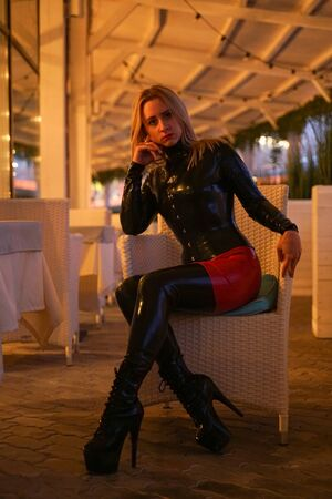 brave girl in latex walks in public and shows her exhibitionism Reklamní fotografie
