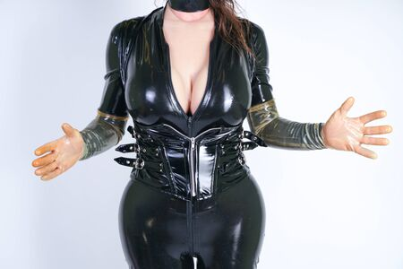 latex fetish plus size person in police doll outfit on white isolated studio background 版權商用圖片 - 128738470