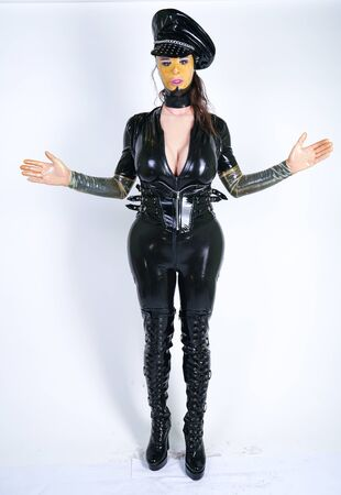 latex fetish plus size person in police doll outfit on white isolated studio background