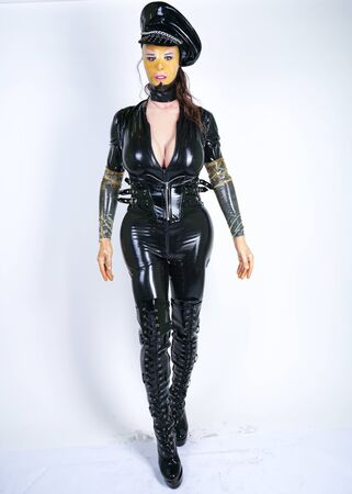latex plus size person in police doll outfit on white isolated studio background