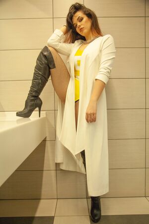 Pretty girl on the big toilet near mirror alone