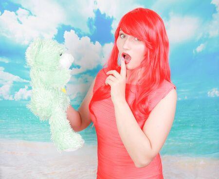 redheaded adult woman punish little cute teddy bear toy