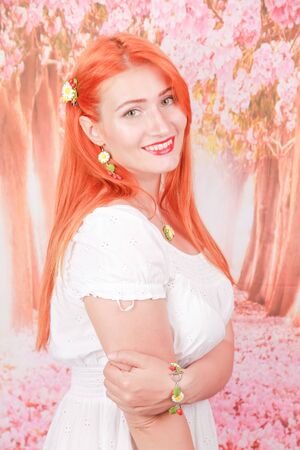 Portrait of girl with orange hair in white summer fashion dress Stock fotó